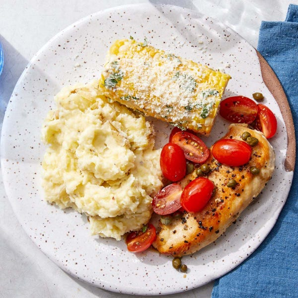 Seared Chicken & Marinated Tomatoes with Fontina Mashed Potatoes & Corn on the Cob