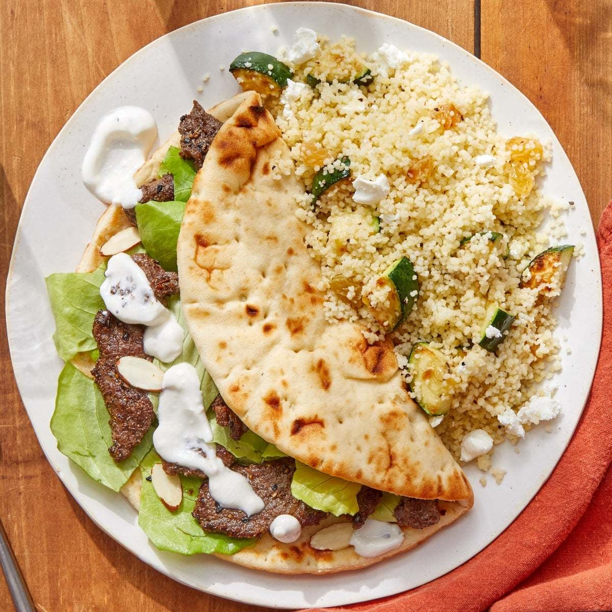 Dukkah Beef Pitas with Goat Cheese, Zucchini  & Raisin Couscous