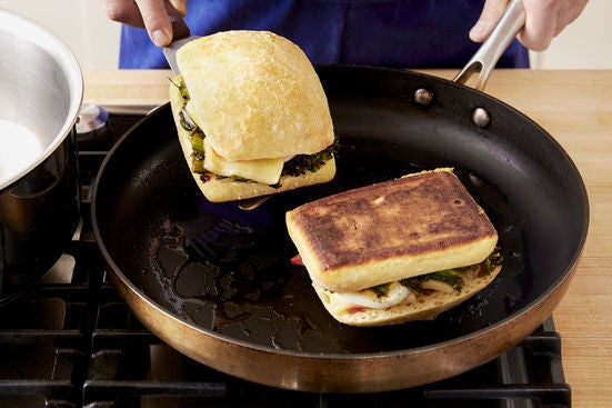 Cook the paninis: