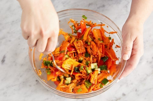 Make the carrot-pepper slaw: