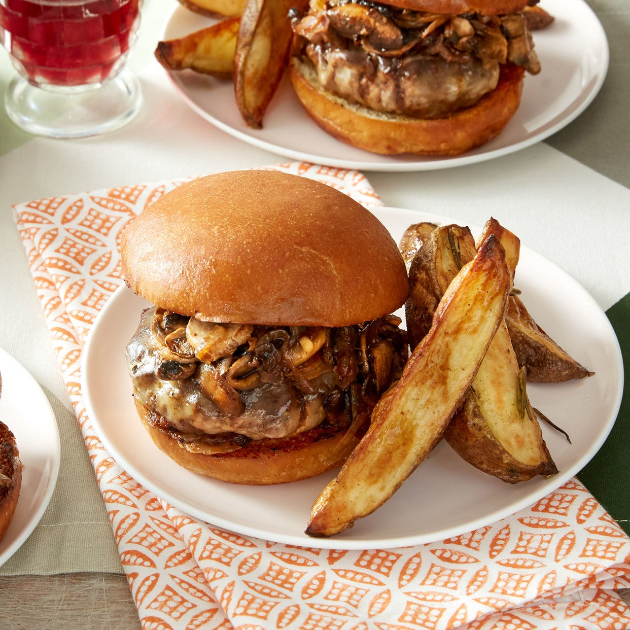 Mushroom & Swiss Cheeseburgers with Roasted Rosemary Potato Wedges