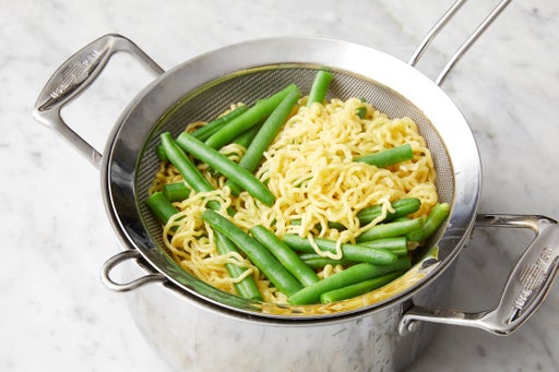 Cook the green beans & noodles: