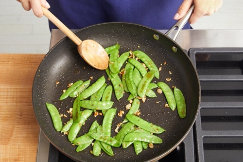 Cook the snow peas: