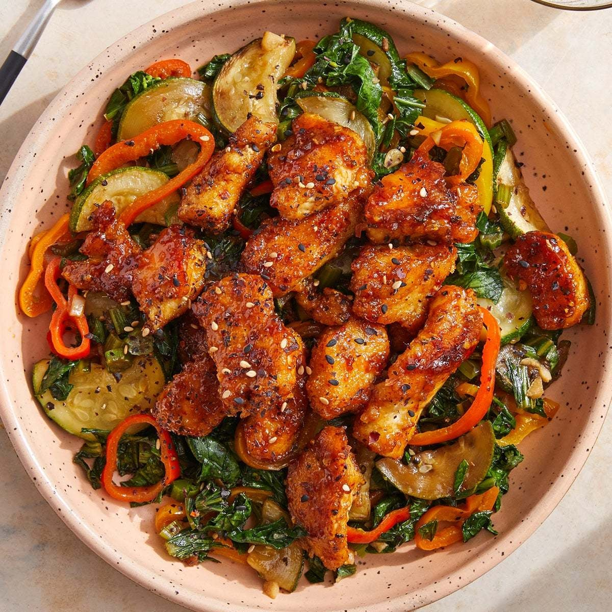 Crispy Curry-Glazed Chicken with Sautéed Zucchini, Peppers & Yu Choy