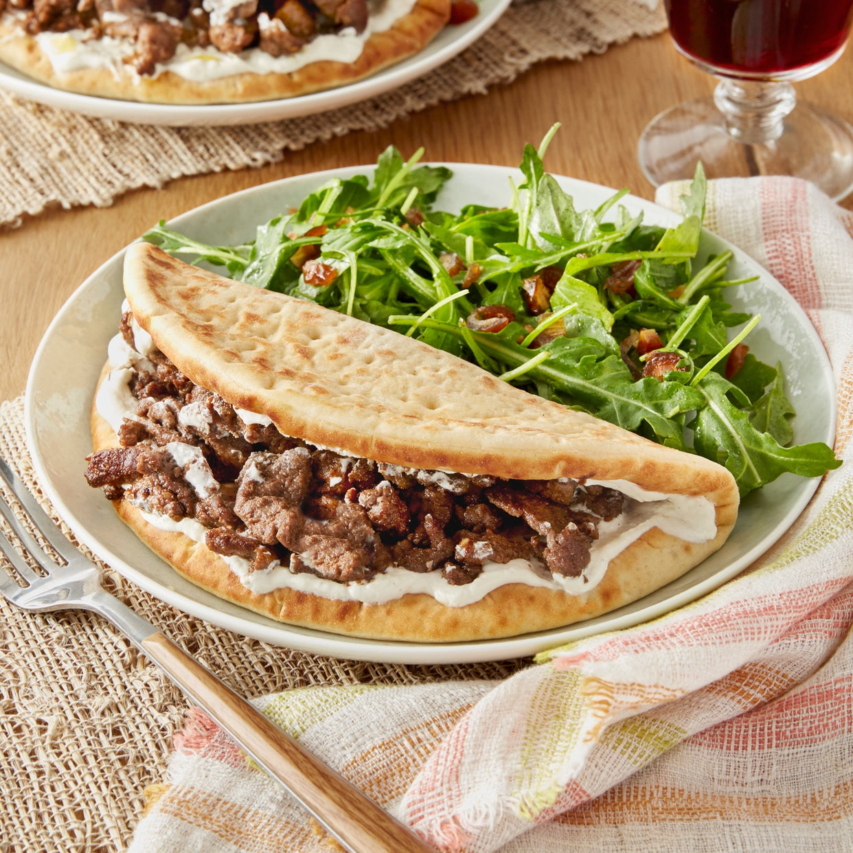 Spiced Beef Pitas & Garlic Labneh with Arugula & Date Salad