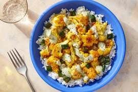 Curry-Roasted Cauliflower & Cilantro Yogurt over Garlic Rice