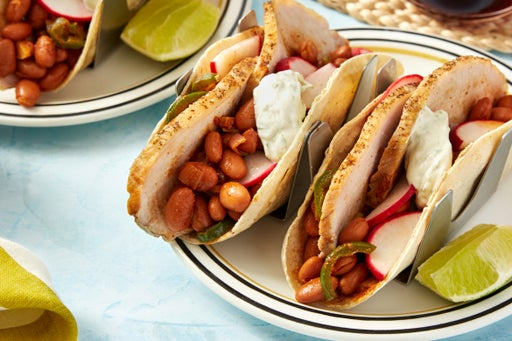 Roasted Pork Tacos with Spicy Pinto Beans & Lime Sour Cream