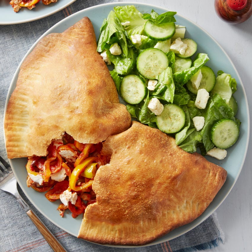 Spicy Pepper & Ricotta Calzones with Cucumber & Romaine Salad