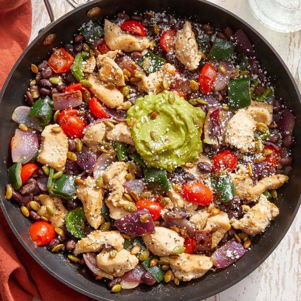 Tomatillo Chicken & Veggie Skillet with Guacamole & Cotija Cheese
