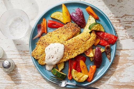 Cornmeal-Crusted Tilapia with Roasted Vegetables & Garlic Yogurt
