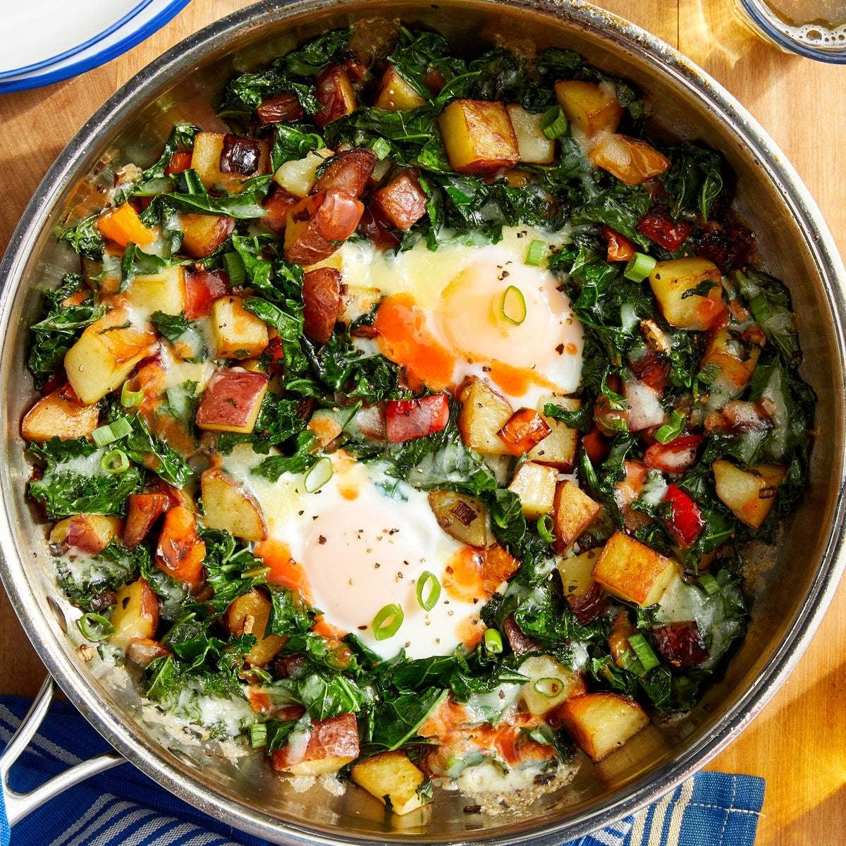 Crispy Potato & Kale Hash with Baked Eggs & Hot Sauce