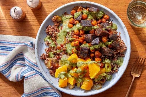 Peruvian-Style Quinoa Bowl with Crispy Chickpeas, Purple Potatoes & Orange