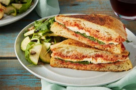 Mozzarella & Arugula Paninis with Marinated Summer Squash & Olive Salad