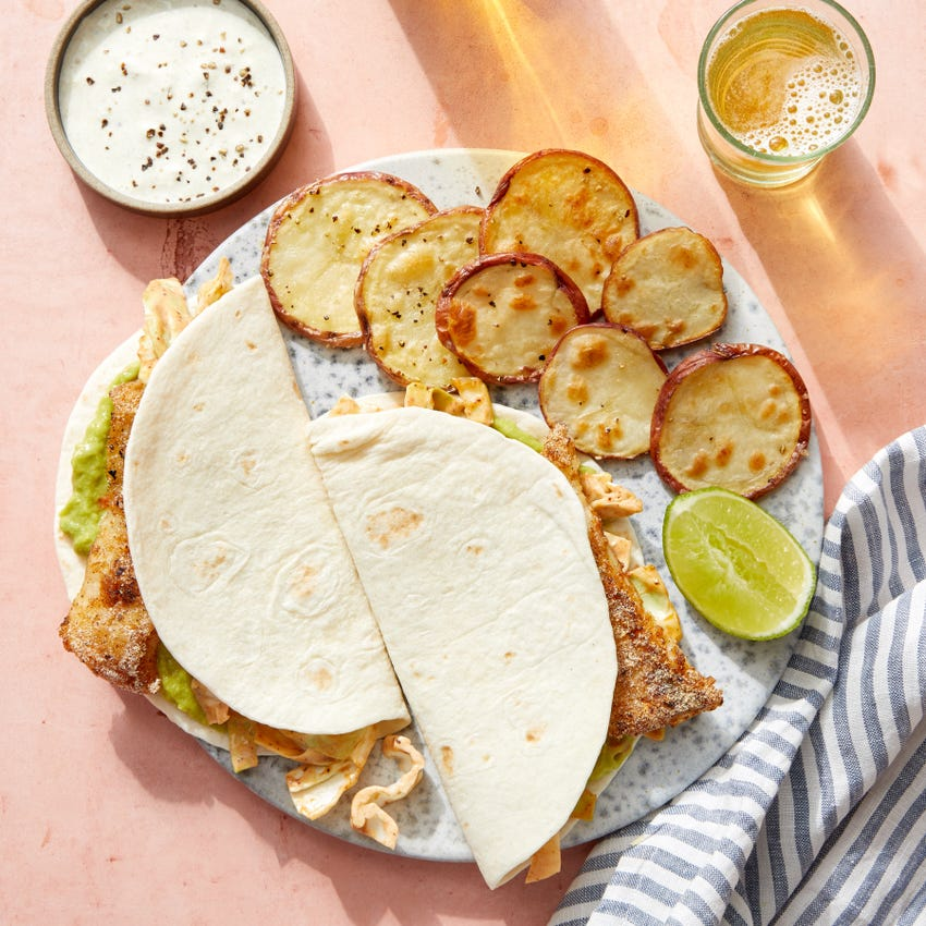 Spicy Fish & Guacamole Tacos with Roasted Potatoes & Tomatillo Sour Cream