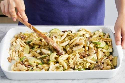 Cook the zucchini & assemble the casserole: