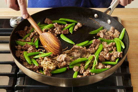 Cook the mushrooms & snap peas: