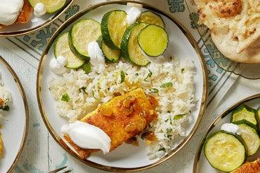 Curry-Spiced Cod & Summer Squash with Ginger-Lime Raisins & Garlic Naan