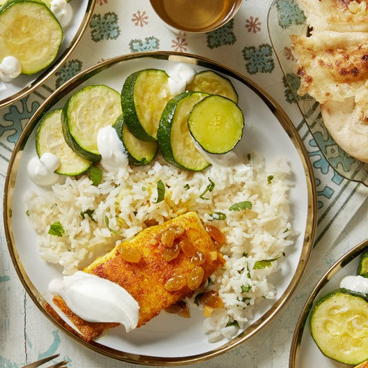 Curry-Spiced Cod & Summer Squash with Ginger-Lime Raisins & Garlic Naan