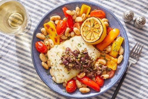 Provençal-Style Cod & Charred Lemon with Sautéed White Beans, Tomatoes & Peppers
