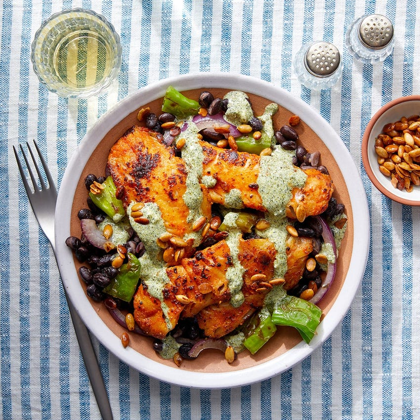 Mexican-Style Fish & Cilantro Sour Cream with Black Beans, Shishito Peppers & Toasted Pepitas