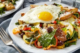 Niçoise-Style Salad with Fingerling Potatoes, Summer Squash, & Fried Eggs