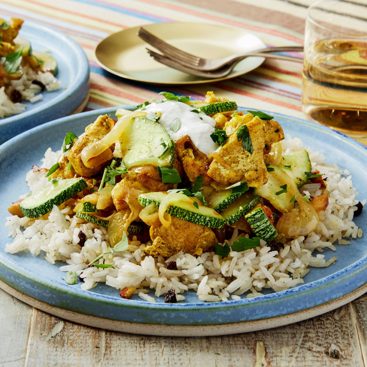 Persian-Style Chicken & Crispy Rice with Summer Squash, Currants, & Lemon Yogurt