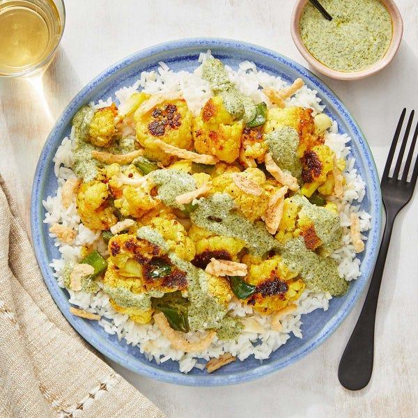 Curried Cauliflower with Garlic Rice & Cilantro-Yogurt Sauce