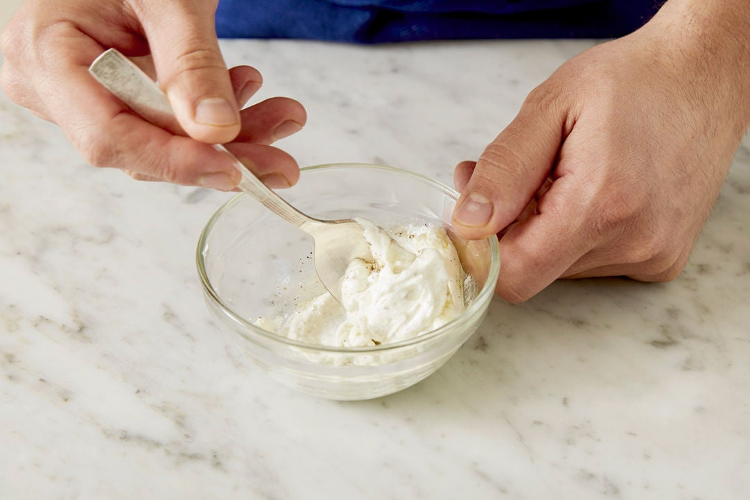 Season the goat cheese: