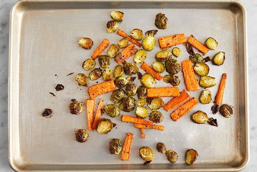 Roast the brussels sprouts & carrots: