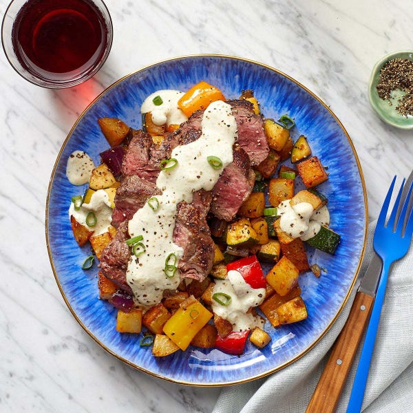 Steaks & Tomatillo Sour Cream with Zucchini, Peppers & Roasted Potatoes