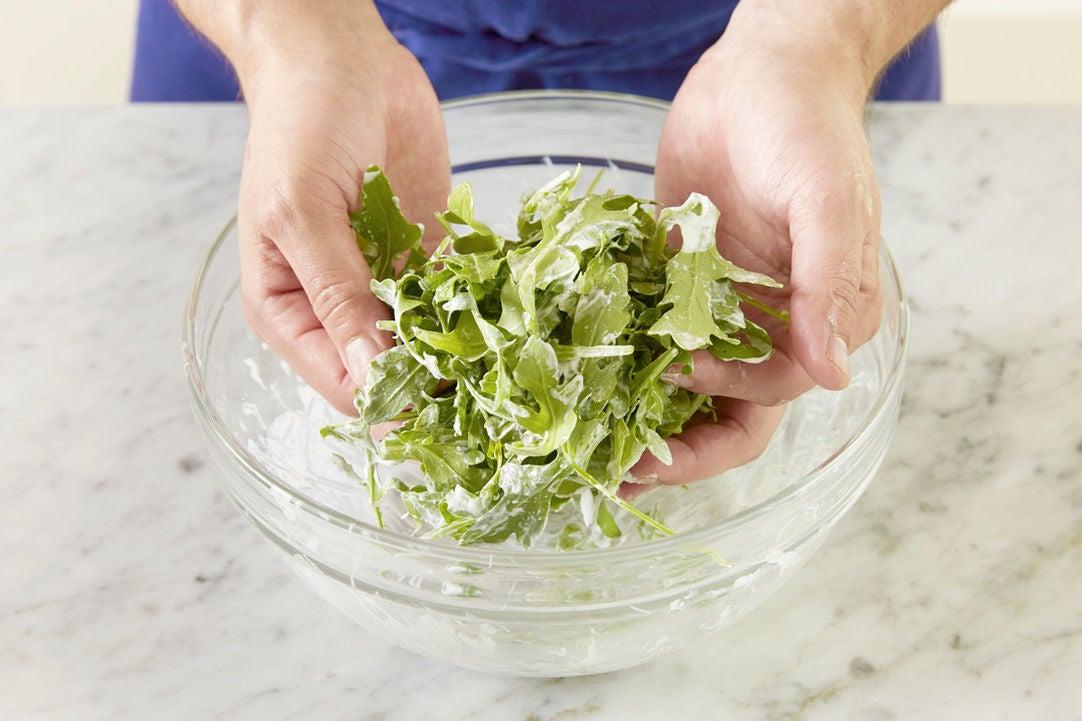 Dress the arugula & plate your dish: