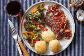 Seared Steaks & Glazed Onion with Garlic Rolls & Roasted Vegetables