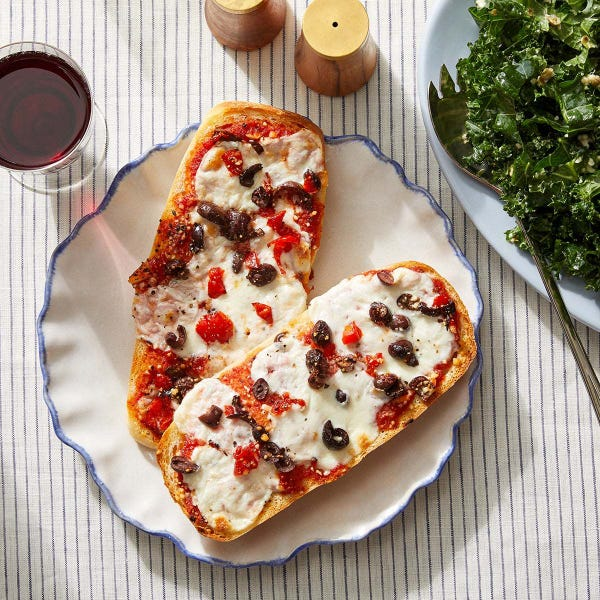 French Bread Pizzas with Kale Caesar Salad