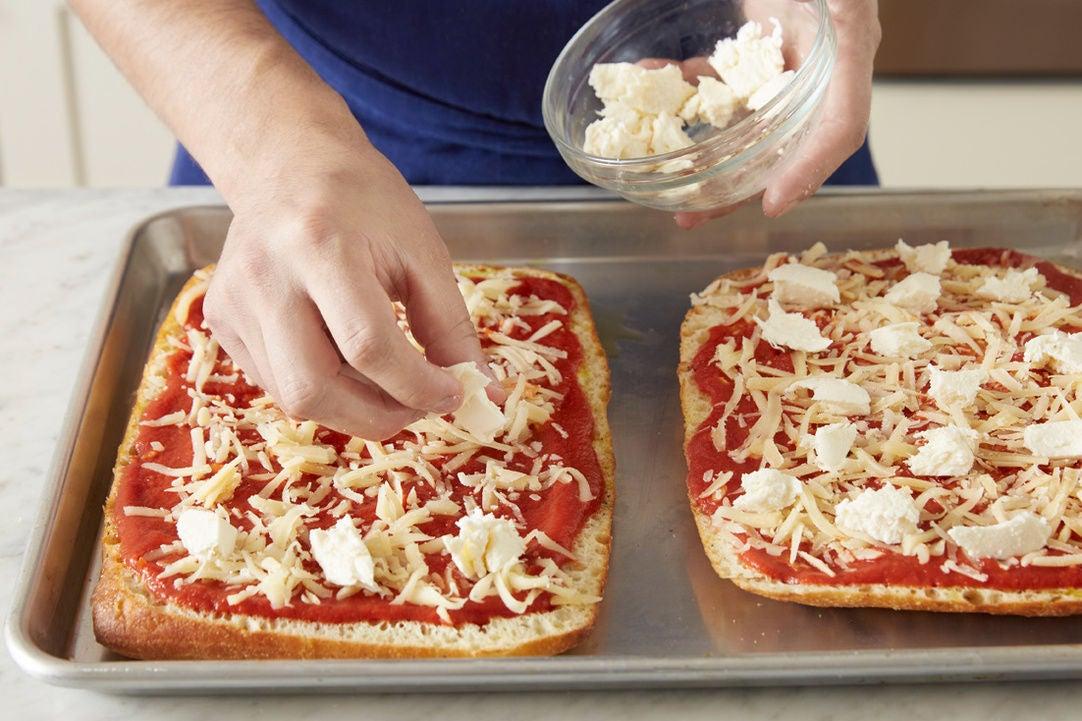 Assemble the pizzas: