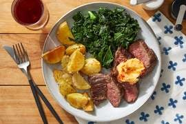Seared Steaks & Chile Butter with Kale & Cheesy Potatoes
