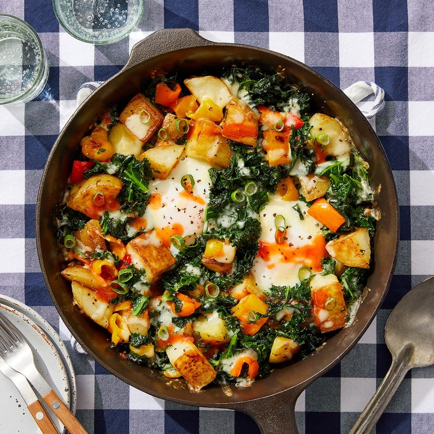 Crispy Potato & Kale Hash with Baked Eggs & Hot Sauce
