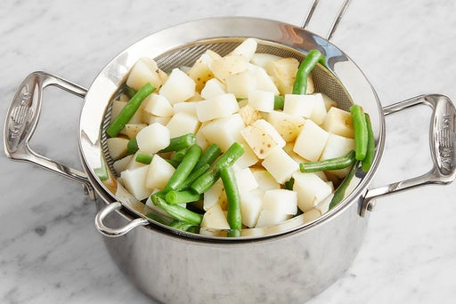 Cook the potatoes & green beans: