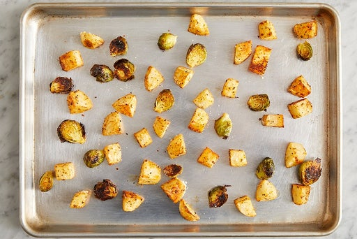 Roast the potatoes & brussels sprouts: