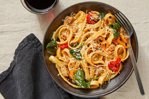 Tuscan Pork Pasta with Romesco Sauce & Spinach