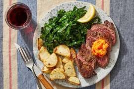Seared Steaks & Calabrian Chile Butter with Collard Greens & Cheesy Potatoes