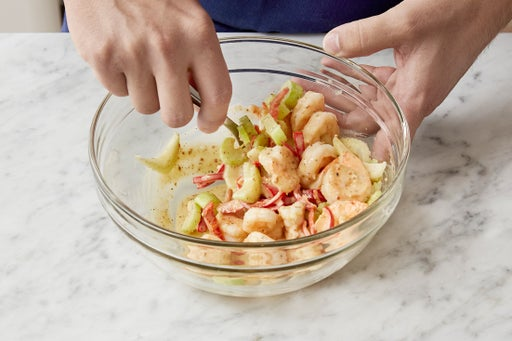 Dress the shrimp & plate your dish: