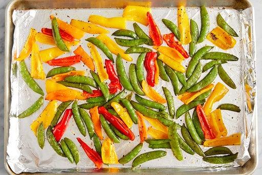 Roast the peas & peppers:
