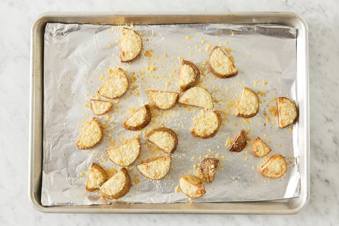 Make the parmesan potatoes: