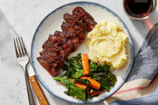 Steaks & Tomato Chutney Pan Sauce with Mashed Potatoes & Cilantro-Dressed Vegetables