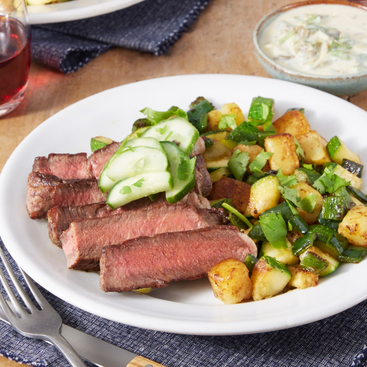 Ribeye Steak & Spicy Vegetable Hash with Marinated Cucumber