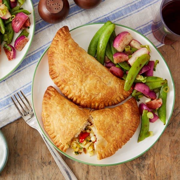 Sweet Corn & Pepper Empanadas with Charred Sugar Snap Peas & Radishes