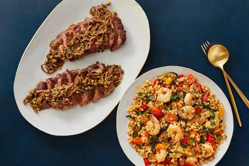 Seared Steak & Shrimp with Fregola Sarda, Spinach & Pistachios