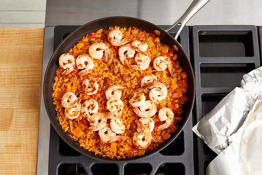 Finish the paella & serve your dish: