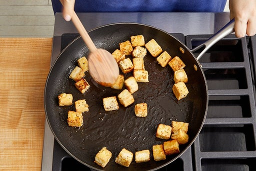 Coat & cook the tofu: