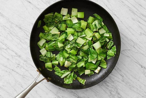 Cook the bok choy & serve your dish: